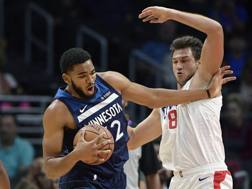 Karl Anthony Towns e Danilo Gallinari. Ap