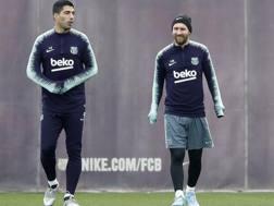 Lionel Messi, con Suarez, in allenamento. Epa