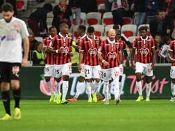 I giocatori del Nizza festeggiano la vittoria. AFP