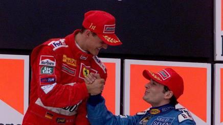 Michael Schumacher con  Giancarlo Fisichella sul podio del Brasile 2000. Lapresse
