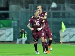Alessandro Diamanti, trequartista del Livorno, col difensore Dario Dainelli. LaPresse