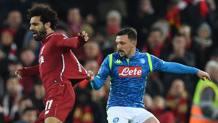 Mario Rui trattiene per la maglia Salah. Afp