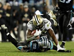 Alvin Kamara, n. 41 dei Saints, supera Mike Adams nel Super Bowl. Afp