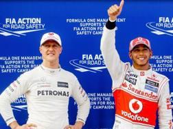 Michael Schumacher e Lewis Hamilton in una foto del 2012. Epa