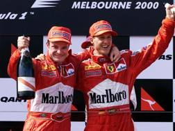 Rubens Barrichello e Michael Schumacher festeggiano il loro primo podio insieme in Ferrari. Afp