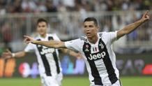 Cristiano Ronaldo esulta dopo l'1-0 al Milan. Ap