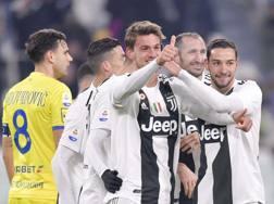 L'esultanza di 3 dei 5 italiani della Juve in campo col Chievo: da sin. Daniele Rugani, Giorgio Chiellini e Mattia De Sciglio