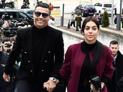 Madrid, Cristiano Ronaldo e Georgina Rodriguez sorridenti anche all'arrivo in tribunale, AFP