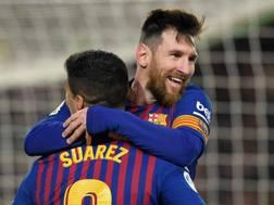 Leo Messi e Luis Suarez. Afp
