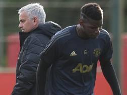 José Mourinho e Paul Pogba. Afp