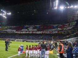 La coreografia dei tifosi rossoneri nel derby d'andata. LaPresse