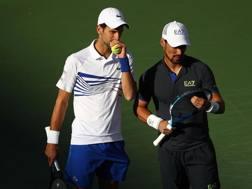 Djokovic e Fognini. Afp