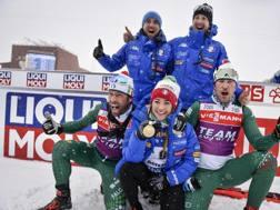 La gioia della squadra con la Wierer. Afp