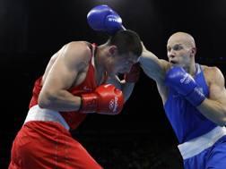 Il russo Evgeny Tishchenko e il kazako Vassiliy levit, sfida nei massimi a Rio 2016. Ap