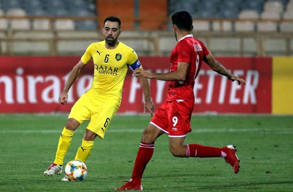 Xavi in azione con la maglia dell'Al-Sadd nell'utlima partita contro il Persepolis, Champions asiatica. Afp