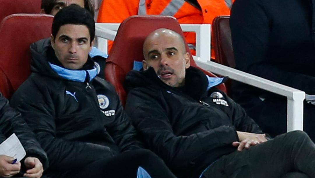 Arteta con Guardiola sulla panchina del City