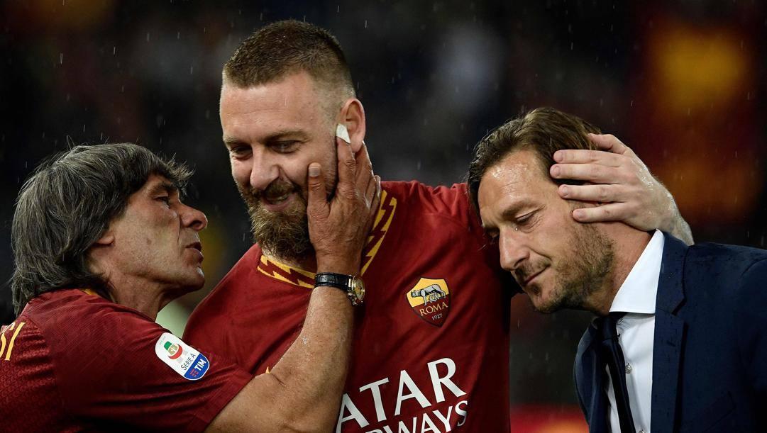 Bruno Conti, Daniele De Rossi e Francesco Totti. Afp