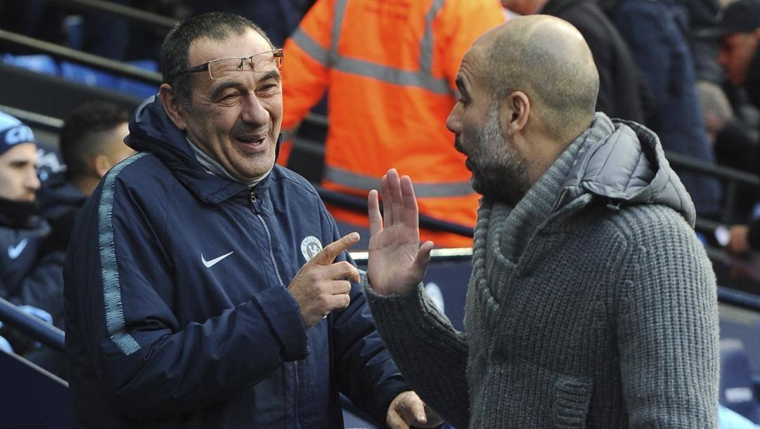 Maurizio Sarri ai tempi del Chelsea con Pep Guardiola. Ap