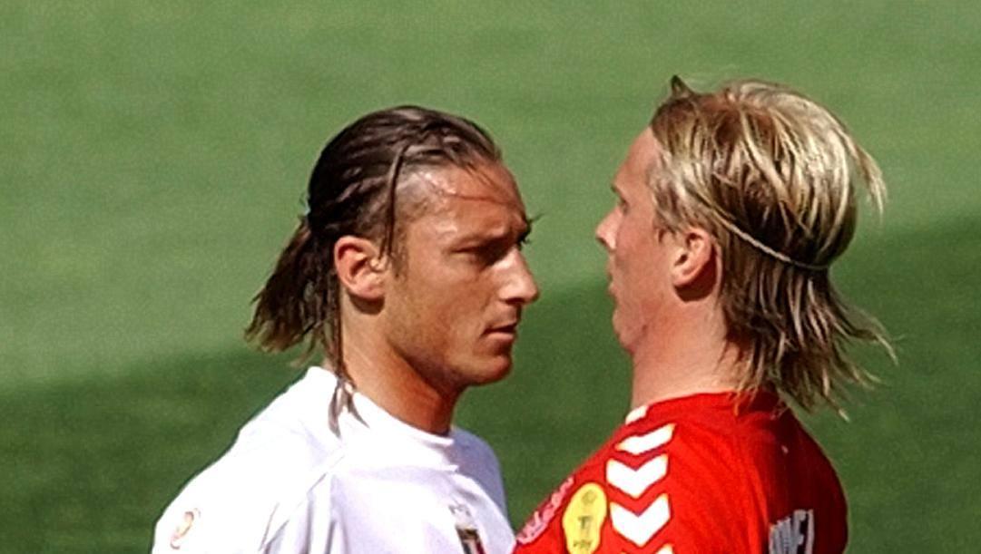 Christian Poulsen con Francesco Totti