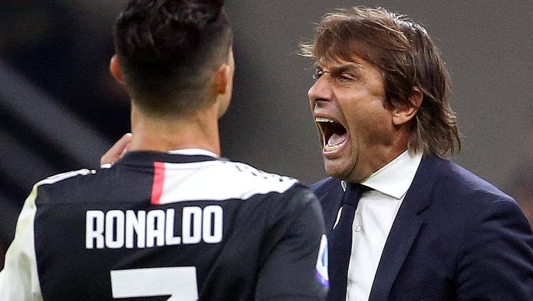 Antonio Conte con Cristiano Ronaldo. Ansa