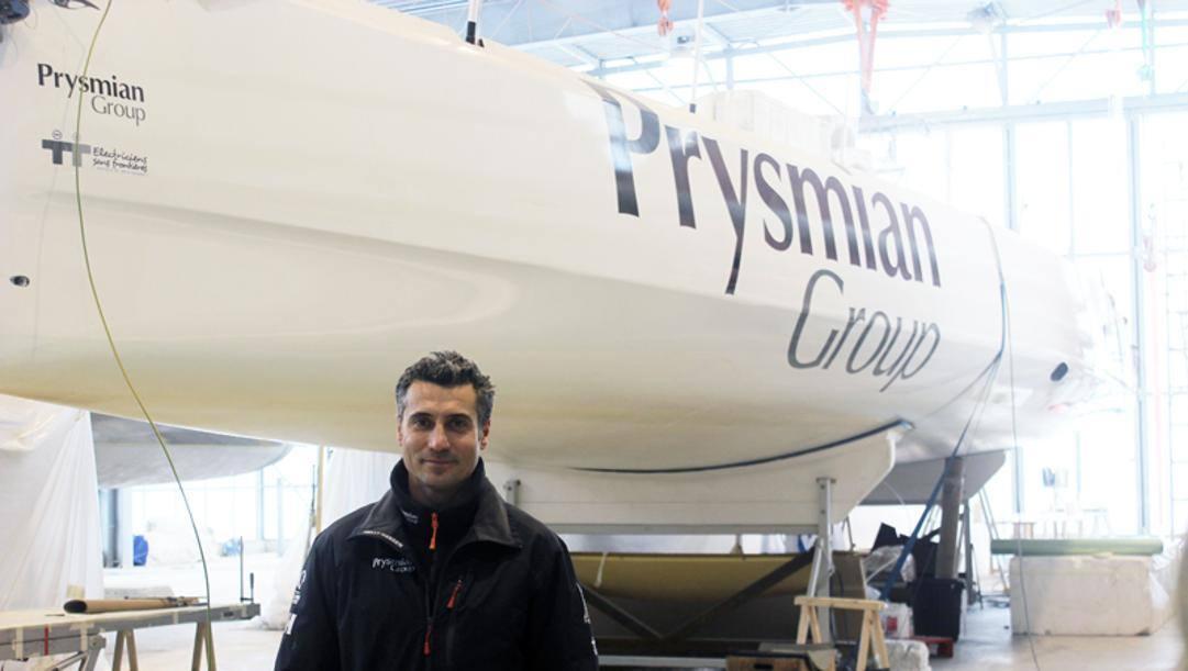 Giancarlo Pedote davanti alla sua barca