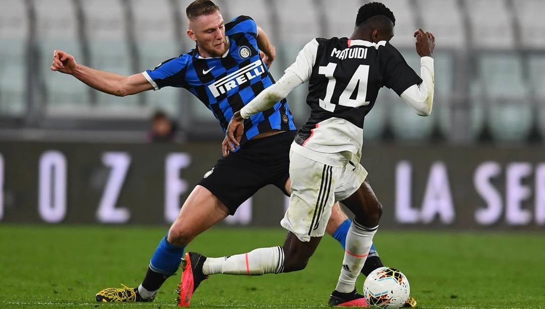 Milan škriniar, 25 anni, con Blaise Mautidi, 32, in Juve-Inter della scorsa settimana. Getty