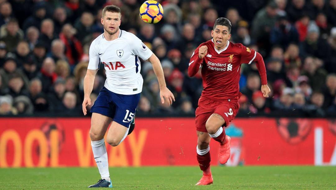 Eric Dier del Tottenham contro Roberto Firmino del Liverpool. Lapresse