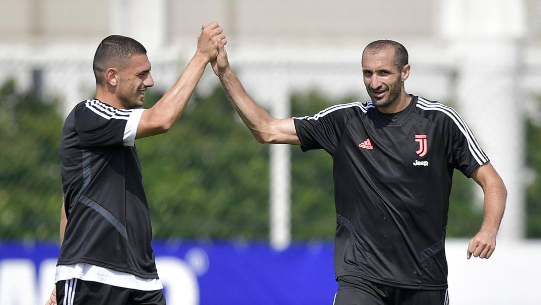 Merih Demiral, 22 anni, e Giorgio Chiellini, 35. Getty