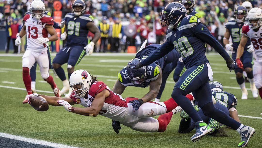 Un touchdown contro Seattle di Larry Fitzgerald, 36 anni, wide receiver dei Cardinals. Afp