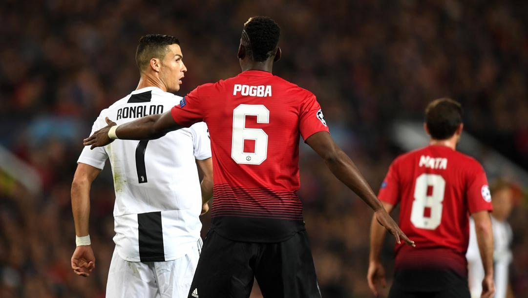 Pogba contro Cristiano Ronaldo, nel Man Utd-Juventus di due anni fa in Champions. Getty