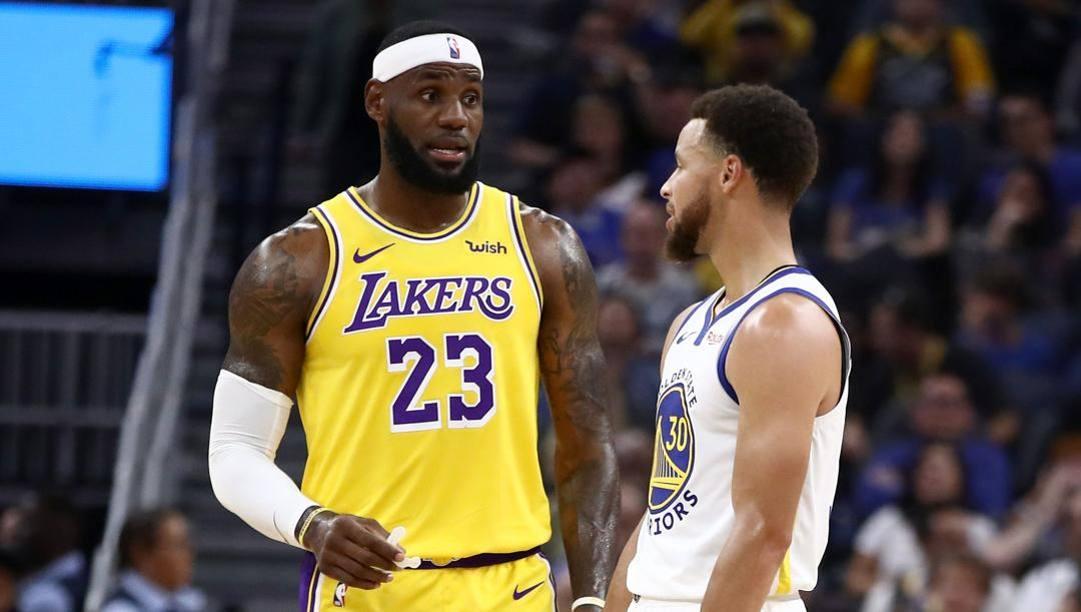 LeBron James e Steph Curry fanno parte della coalizione di star che spinge per ricominciare. Afp
