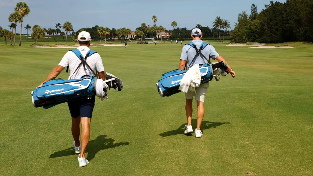 Dustin Johnson e Rory MvIlroy in Florida senza caddie. Afp