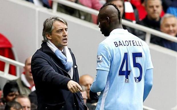 Mario Balotelli con Roberto Mancini al City. Ansa