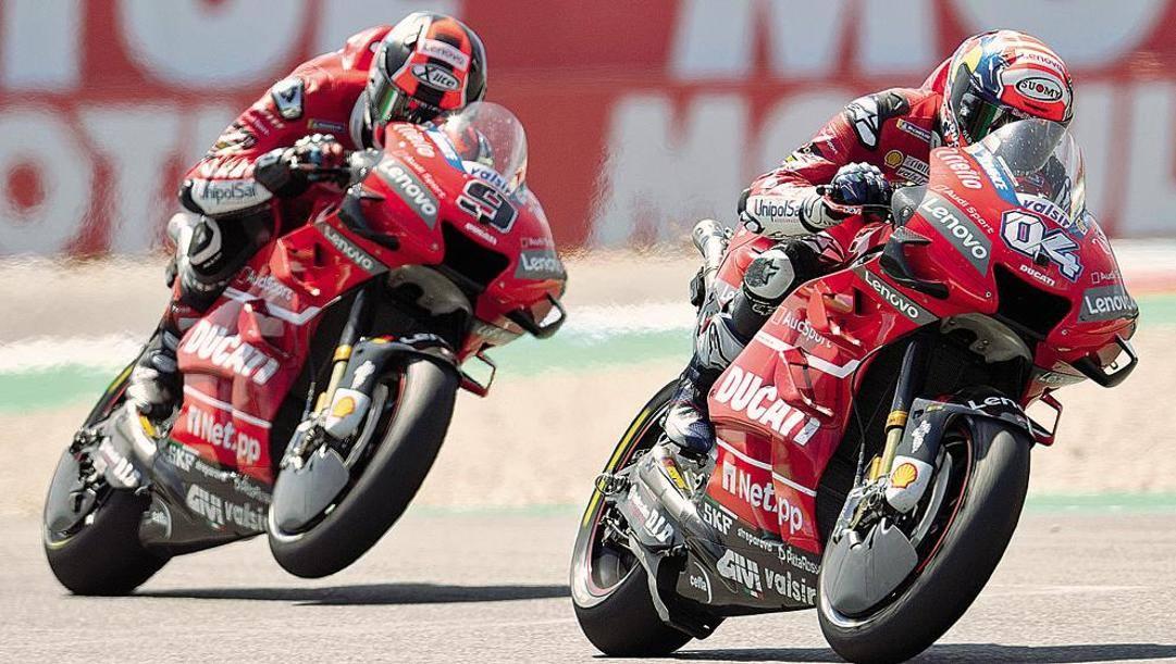 Andrea Dovizioso, 34 anni, e Danilo Petrucci, 29, in azione con le Ducati. Getty