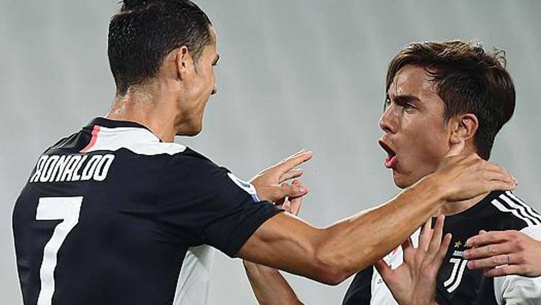 Cristiano Ronaldo e Paulo Dybala. Afp