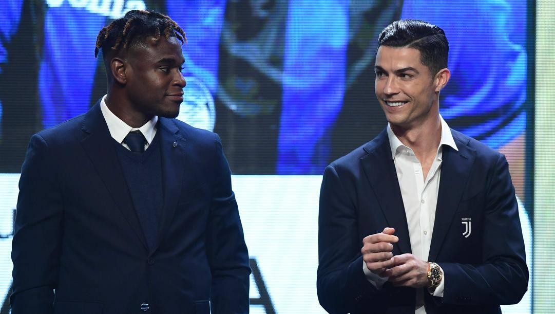 Duvan Zapata e Cristiano Ronaldo. Afp
