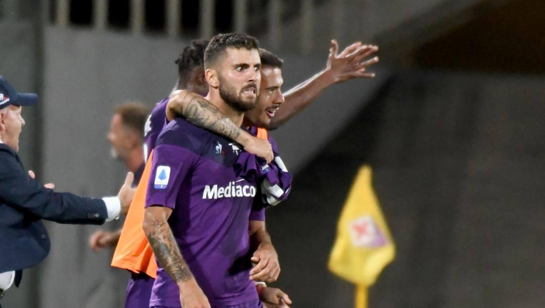 La grinta di Patrick Cutrone, autore del gol del pareggio nel recupero. Ansa