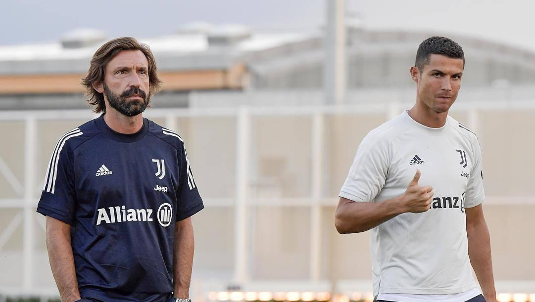 Andrea Pirlo con Cristiano Ronaldo. il mister e la sua stella. Getty