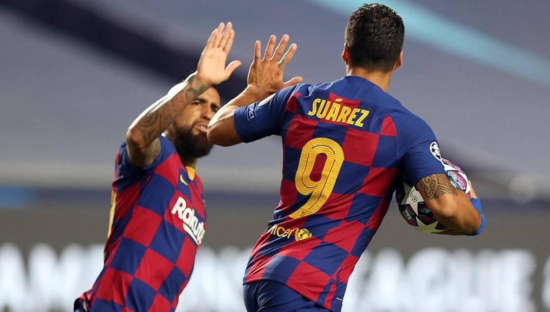 Vidal e Suarez, attualmente al Barça, ma corteggiati da Inter e Juve. EPA