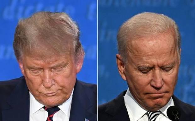 Donald Trump e Joe Biden a testa bassa. Afp