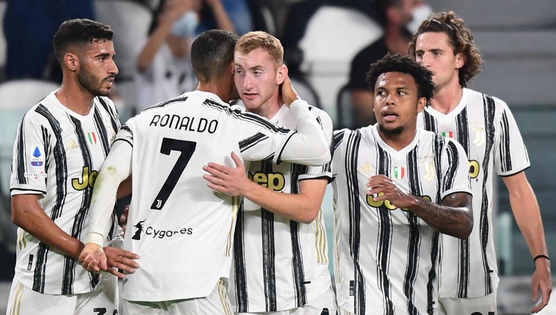 Ronaldo con Kulusevski, Frabotta e McKennie. Afp