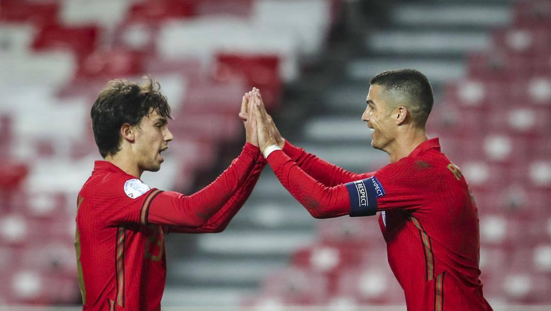Joao Felix e Cristiano Ronaldo festeggiano. Epa