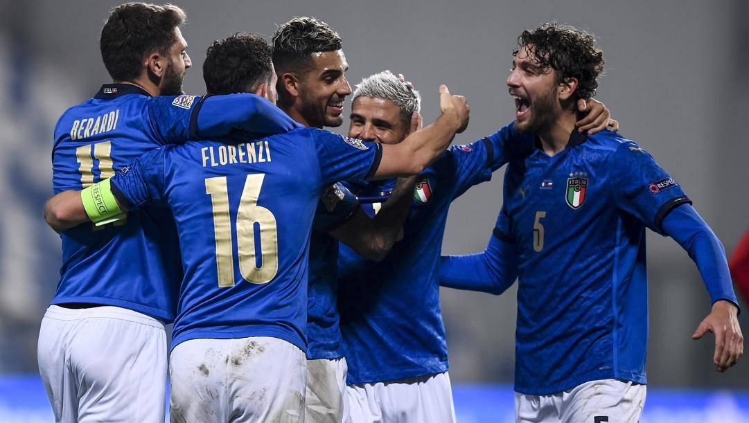 I calciatori dell'Italia esultano. Lapresse