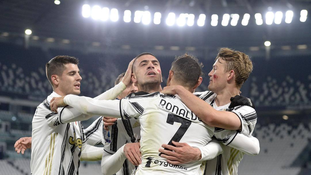 Morata, Demiral e De Ligt abbracciano Ronaldo. Getty