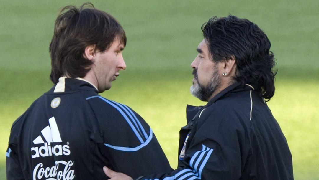 Lionel Messi e Diego Armando Maradona. Epa