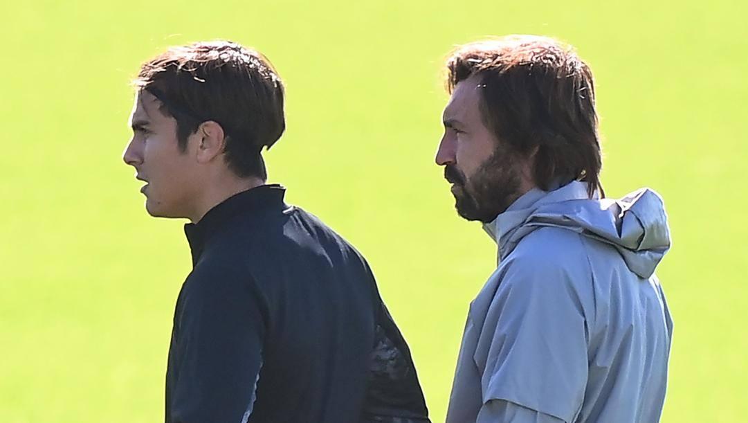 Paulo Dybala e Andrea Pirlo. Afp