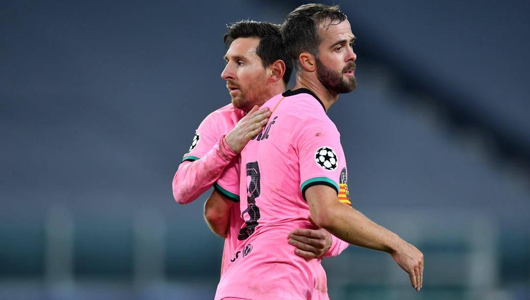 Pjanic con Messi. Getty