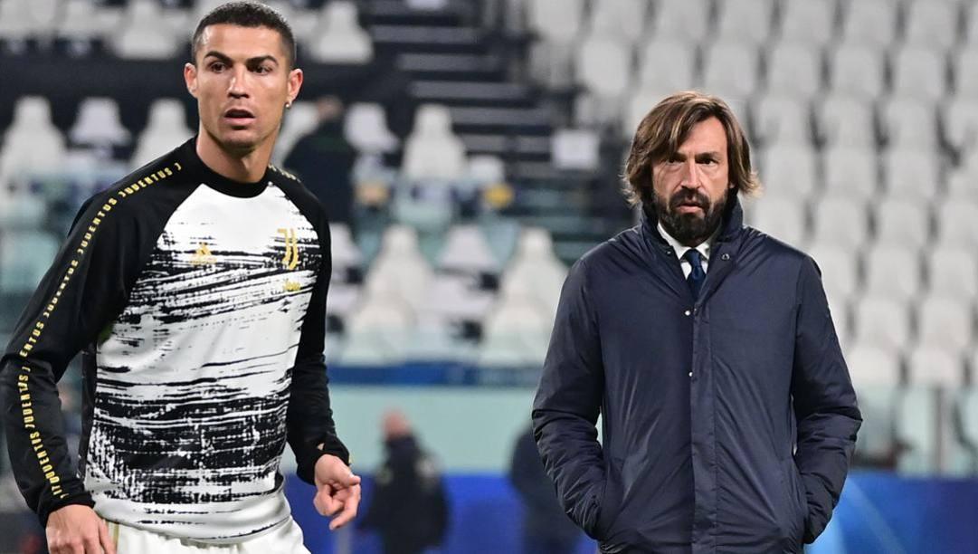 Cristiano Ronaldo con Andrea Pirlo. Afp