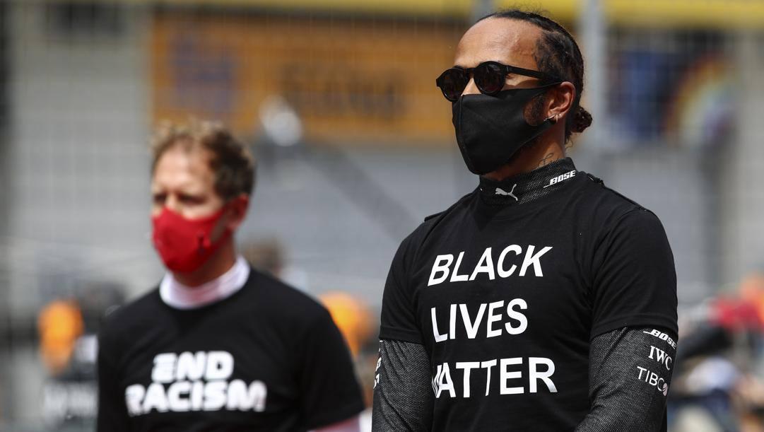 L'impegno di Lewis Hamilton e Sebastian Vettel contro il razzismo. Lapresse