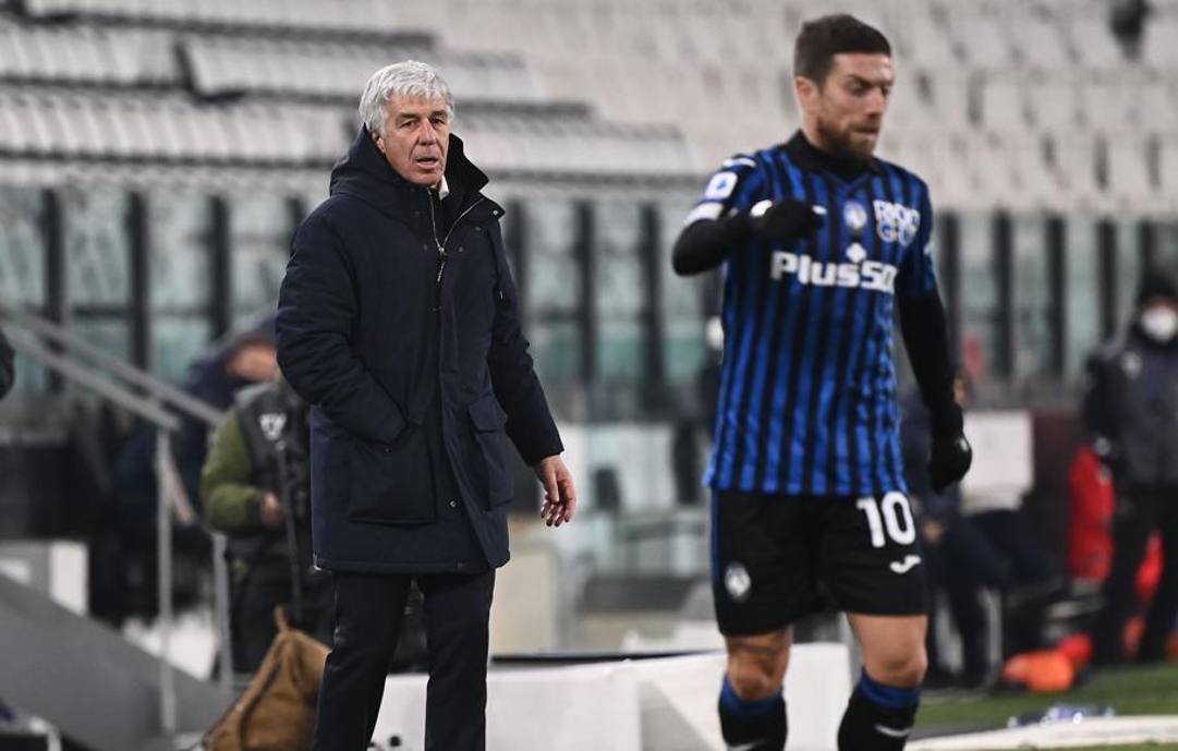 Gian Piero Gasperini con il Papu Gomez. Afp